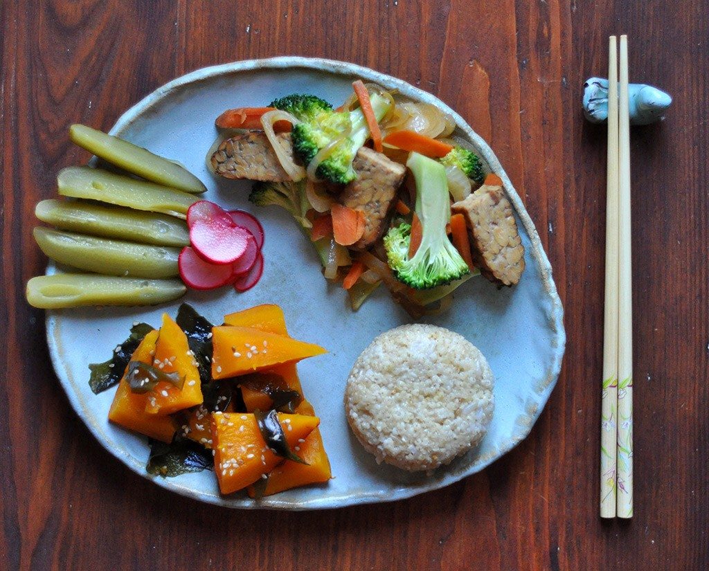 sweet millet, nishime pumpkin & wakame, cucumber salty pickle & fast umesu radishpickle, wokked veggies & smoked tempeh